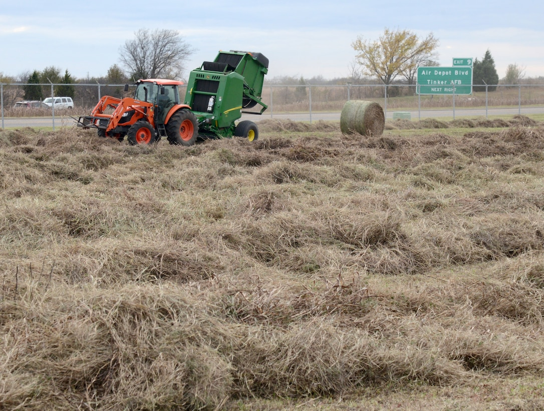 Hay is machine-baled on the land in front of Bldg. 9001 on Tinker AFB. In lieu of paying someone to mow the area, the land is leased for haying purposes. The lessee pays the government an annual fee and can keep the hay or sell it and keep the profit.