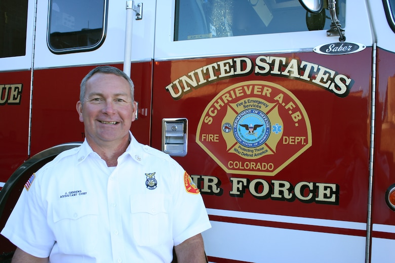 Schriever assistant fire chief shaves mustache for breast cancer awareness