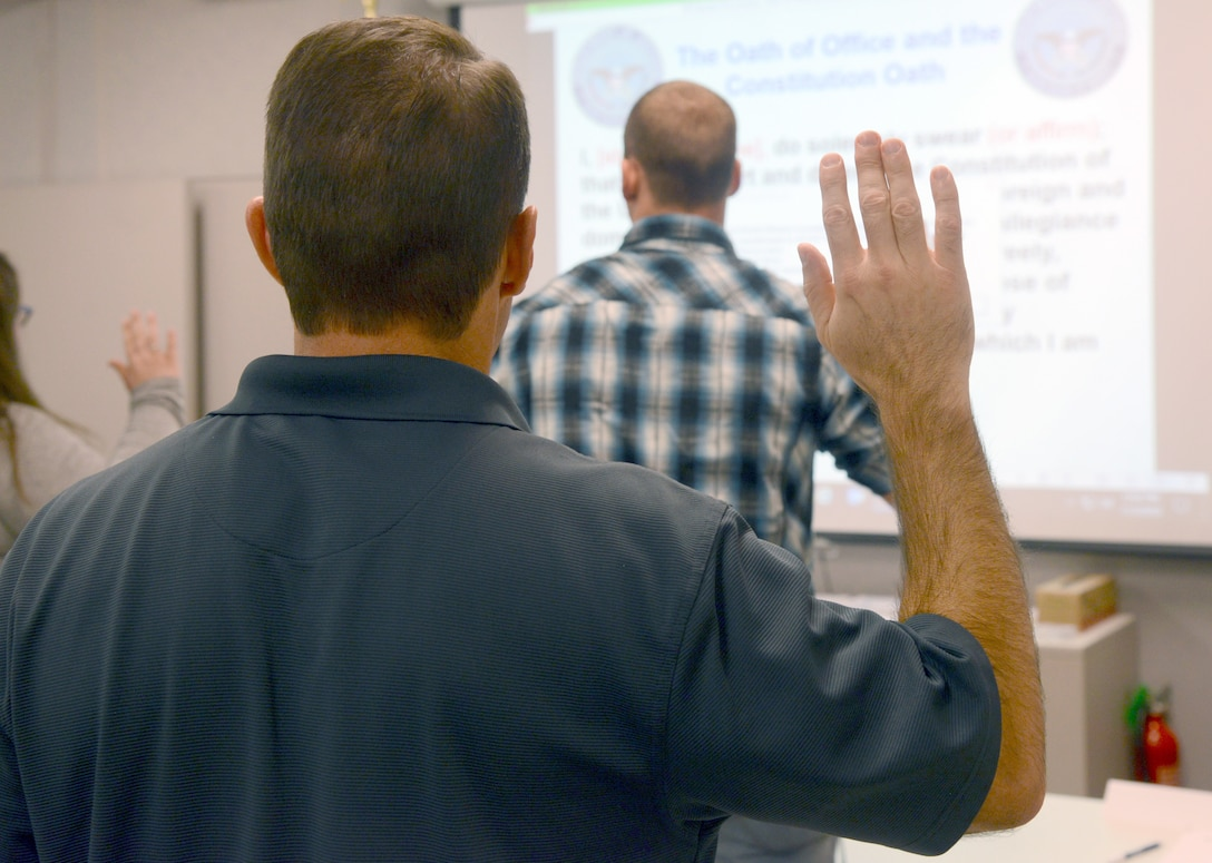 During newcomer orientation, new Department of Defense employees raise their right hand to support the Constitution of the United States. Not to be taken lightly, the oath is a public statement of commitment, pledging allegiance to the nation and binding that individual to see the mission succeed.