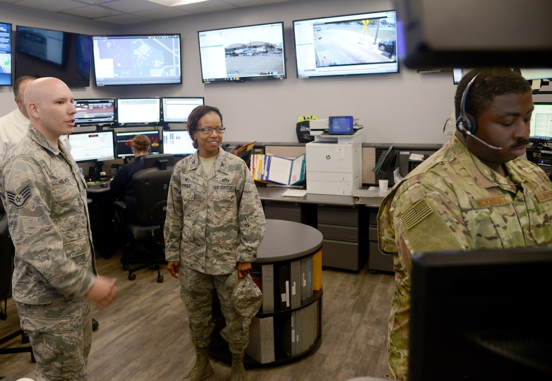 Staff Sgt. Rafe Holmes, 72nd Security Forces Squadron, guides Col. Yvonne Spencer through Tinker Air Force Base's Emergency Communication Center during her visit Oct. 30-31. Spencer, Air Force Installation and Mission Support Center Det. 6 commander, met with 72nd Air Base Wing leadership and had breakout sessions and tours with organizations across the wing to gain insight into installation needs to better advocate for AFIMSC resources.