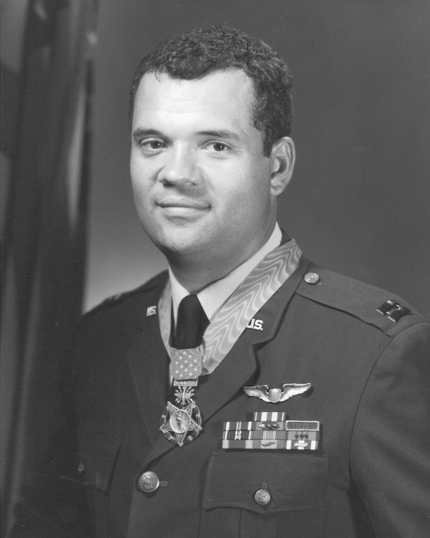 Then-Air Force Capt. James P. Fleming poses while wearing the Medal of Honor.