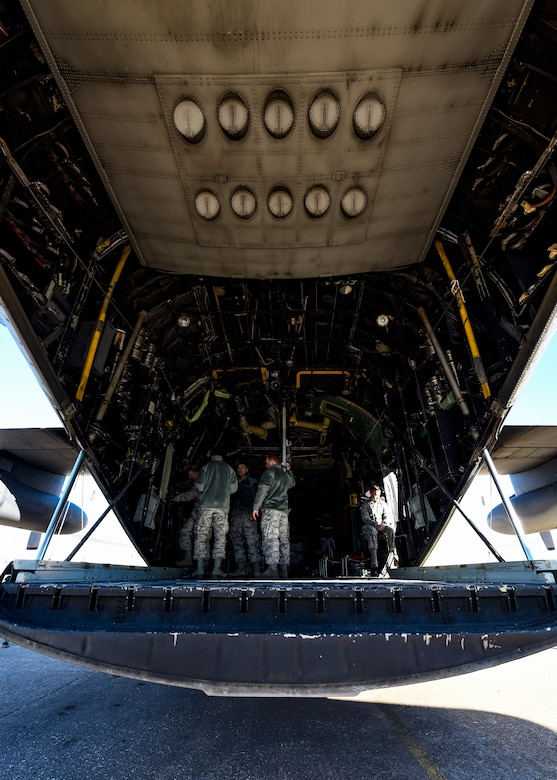 Sheppard Airmen in training work on a C-130 Hercules trainer jet.
