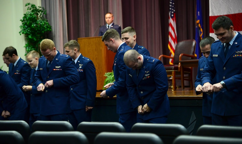 Col. Stephen Snelson, 6th Air Mobility Wing commander, Macdill Air Force Base, Florida, speaks at Specialized Undergraduate Pilot Training Class 19-02's graduation Nov. 16, 2018, on Columbus Air Force Base, Mississippi. He told the class not to back down from changing and innovating in the face of unwilling superiors, he asked them to be bold and strive for the best they can do at all times, and the final point he explained was to pick their heads up and appreciate what they are doing and what they have done. (U.S. Air Force photo by Airman 1st Class Keith Holcomb)