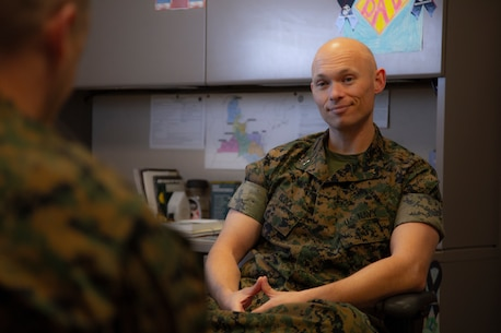 179ce24dddc Chaplain sitting in office talking to a Marine