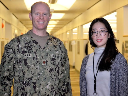 Navy Lt. Cmdr. Jason Galka, a Medical Customer Pharmacy Operations Center pharmacist, left, and Sooyun Kim, a Medical CPOC pharmacist, right, pose for a photo at DLA Troop Support, Nov. 21, 2018 in Philadelphia.