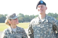 West Virginia Army National Guard (WVARNG) recruiter Staff Sgt. Lynda Tulanowski stands with her son, Aaron, during his graduation from Basic Combat Training nine years ago.