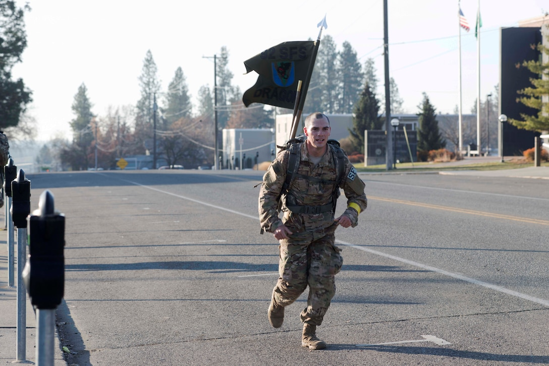 U.S. Air Force Senior Airman Joseph Pace, 92nd Security Forces Squadron installation patrolman, participates in the road ruck-march of the German Armed Proficiency Badge competition Nov. 18, 2018, at Eastern Washington University in Cheney, Washington. Competing for the GAFPB is just one of many opportunities available for Fairchild Airmen to test their proficiency while working alongside foreign allies, National Guard and active duty members from other service branches. (U.S. Air Force photo/Airman 1st Class Lawrence Sena)