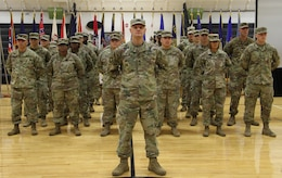 FORT KNOX, Ky. - Capt. Petro Mycio, officer in charge for the Alpha Company of 1st Theater Sustainment Command stands at parade rest in front of his unit during the deployment ceremony at the Sadowski Center, Nov 19. The team, comprised of Soldiers and Department of the Army Civilians, deploying to Kuwait where they will assume the Strategic Operations and Plans (SOaP) mission. (U.S. Army photo by Spc. Zoran Raduka)