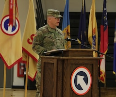 FORT KNOX, Ky. - Col. Sidney Melton, chief of staff for the  1st Theater Sustainment Command, speaks during the deployment ceremony at the Sadowski Center, Nov 19. The team, comprised of Soldiers and Department of the Army Civilians, deploying to Kuwait where they will assume the Strategic Operations and Plans (SOaP) mission. (U.S. Army photo by Spc. Zoran Raduka)