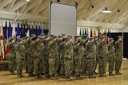 FORT KNOX, Ky. - The 1st Theater Sustainment Command Soldiers comprised of the Red Team and Alpha Company salute during the deployment ceremony at the Sadowski Center, Nov 19. The team, comprised of Soldiers and Department of the Army Civilians, deploying to Kuwait where they will assume the Strategic Operations and Plans (SOaP) mission. (U.S. Army photo by Spc. Zoran Raduka)