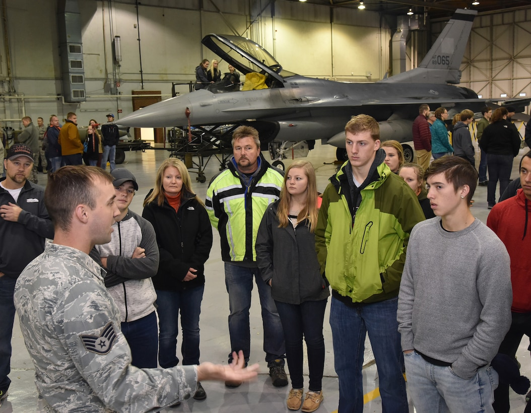 Staff Sgt. Isaac Druin, 114th Civil Engineer Squadron emergency management technician, explains to career day attendees about the functions of the Mobile Emergency Operation Center and the benefits of his career with the 114th Fighter Wing.