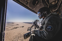 Sgt. Cade Allen, a UH-1Y Venom crew chief with Marine Medium Tiltrotor Squadron 163 (Reinforced), 11th Marine Expeditionary Unit, scans the ground below on a flight during Realistic Urban Training exercise at Naval Air Facility, El Centro, Calif., Nov. 12, 2018. Crew chiefs act as another set of eyes for pilots and are responsible for the overall well-being of the helicopter and its crew, particularly the operations conducted in the rear of the aircraft. (U.S. Marine Corps photo by Cpl. Adam Dublinske)