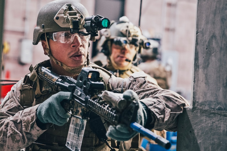 Reconnaissance Marines with the Maritime Raid Force (MRF), 11th Marine Expeditionary Unit (11th MEU), conduct a raid to extract a high value target during Realistic Urban Training in Reno, Nev., Nov. 14, 2018. The MRFs role in a MEU is to carry out raids against maritime objectives such as oil and gas platforms, ships as well as targets ashore. (U.S. Marine Corps photo by Cpl. Matthew Teutsch)