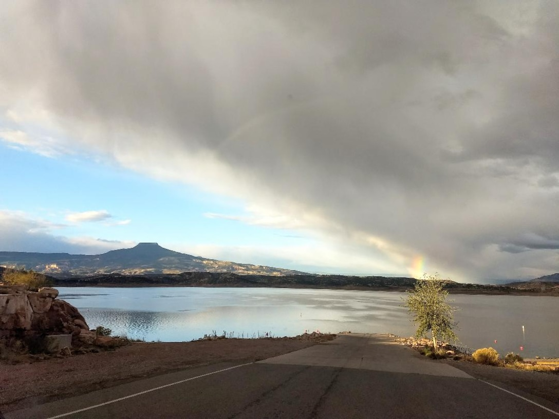 ABIQUIU LAKE, N.M. – A short span of a rainbow at the end of some storm clouds is seen from the boat ramp at the lake, Aug. 1, 2018. Photo by Clarence Maestas. This was a 2018 photo drive entry.