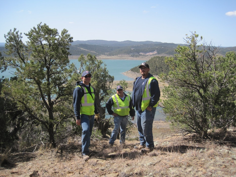 "TRINIDAD LAKE, Colo. – District maintenance staff stop for a photo while conducting boundary line surveys, April 1, 2018. (l-r): Jesse Gutierrez, Joseph ""Rick"" Torres, and Matt Gonzales. Photo by Kim Falen. This was a 2018 photo drive entry."