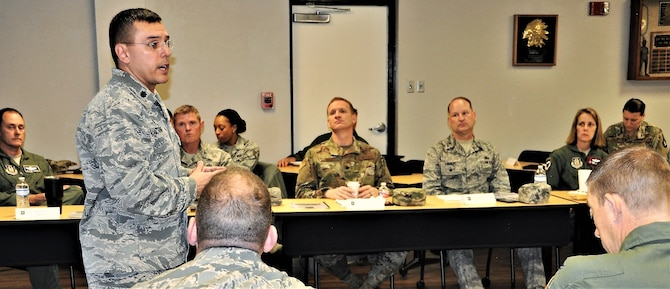 Lt. Col. Christopher Victoria, 433rd Training Squadron commander, provides a mission brief during the 22nd Air Force Senior Leader Summit Nov. 14 at Joint Base San Antonio-Lackland, Texas. (U.S. Air Force photo by Janis El Shabazz).