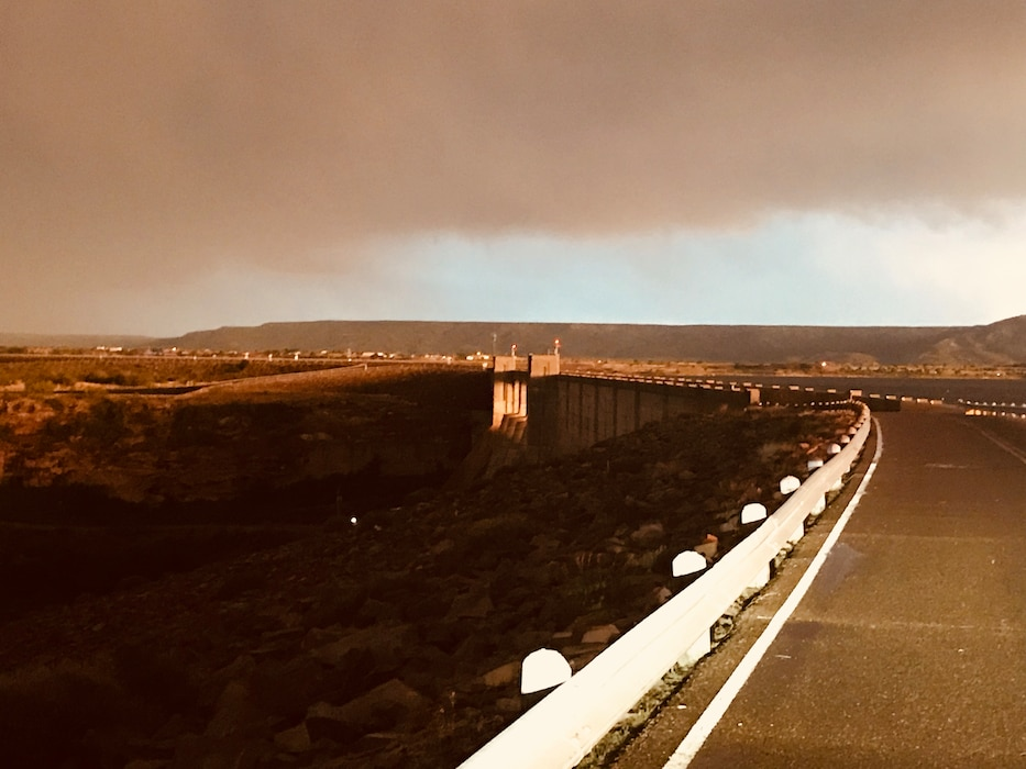 CONCHAS DAM, N.M. – Sunlight glows through the dam right before a storm moves in, May 19, 2018. Photo by Nadine Carter. This was a 2018 photo drive entry.