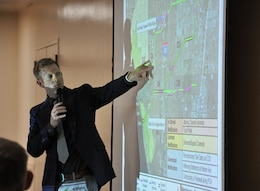 Justin Golliher with the Engineering Division of the Orange County Public Works, points out an area on the map of the Westminster Watershed for a community member during a Nov. 7 public meeting about the Westminster/East Garden Grove Flood Risk Management Study in Westminster, California. The U.S. Army Corps of Engineers Chicago and Los Angeles districts are partnering with the Orange County Public Works on a proposed project to reduce flood risk in the area.
