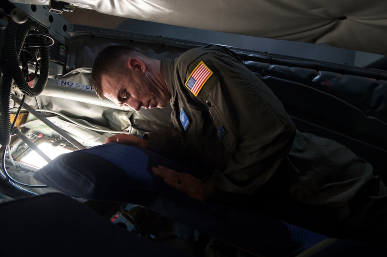 Master Sgt. Christopher Joyce, a boom operator assigned to the 56th Air Refueling Squadron, examines a new boom pod bed Nov. 20, 2018, Altus Air Force Base, Okla. The new boom pod was the winning idea on the Air Force Spark Tank and will be added into every KC-135 Stratotanker.
