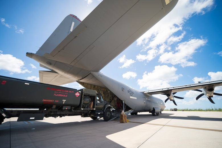 Airmen with the 36th Mobility Response Squadron, assigned to Andersen Air Base, Guam, load a fuel truck onto a C-130J Super Hercules during flight line operations in Saipan, Commonwealth of the Northern Mariana Islands, Nov. 20, 2018, as part of the Super Typhoon Yutu relief effort.
