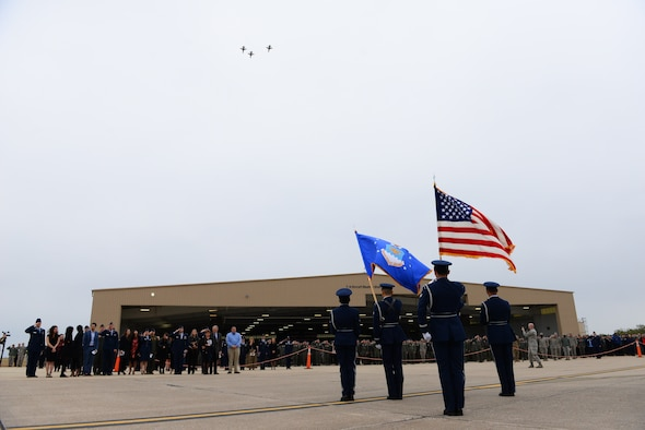 The 87th Flying Training Squadron honors Capt. John Graziano, 87th FTS instructor pilot through a T-38C Talon missing-man formation flyover while the base honor guard presented colors, ending his memorial service on Nov. 21, 2018, at Laughlin Air Force Base, Texas. Members of the base, community, and U.S. Congressman Will Hurd gathered to pay their respects to an aviator who lost his life doing what he loved. (U.S. Air Force photo by Senior Airman Benjamin Valmoja)