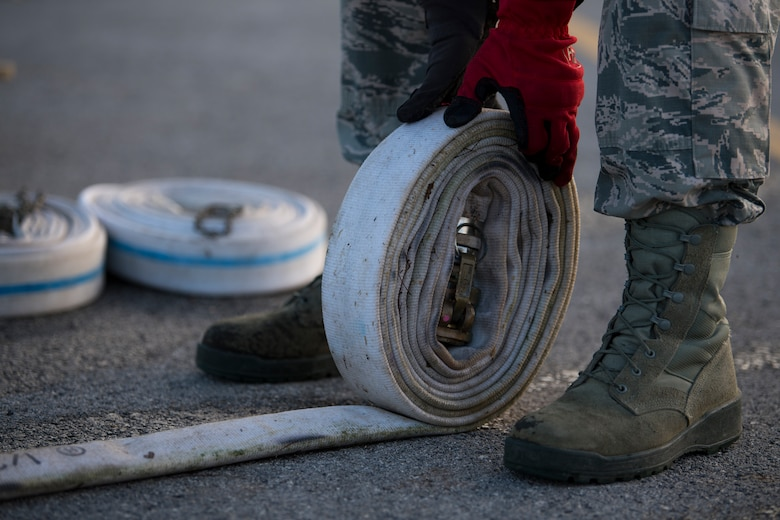 Staff Sgt. Martin Figueroa Ortiz, 36th Civil Engineer Squadron electrical systems maintainer assigned to Andersen Air Base, Guam, rolls up a hose during reverse osmosis water purification unit tear down on Saipan, Commonwealth of the Northern Mariana Islands, Nov. 21, 2018, as part of the Super Typhoon Yutu relief effort.