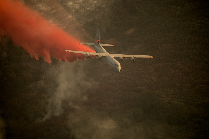 A National Guard C-130J Super Hercules equipped with the Modular Airborne Fire Fighting System