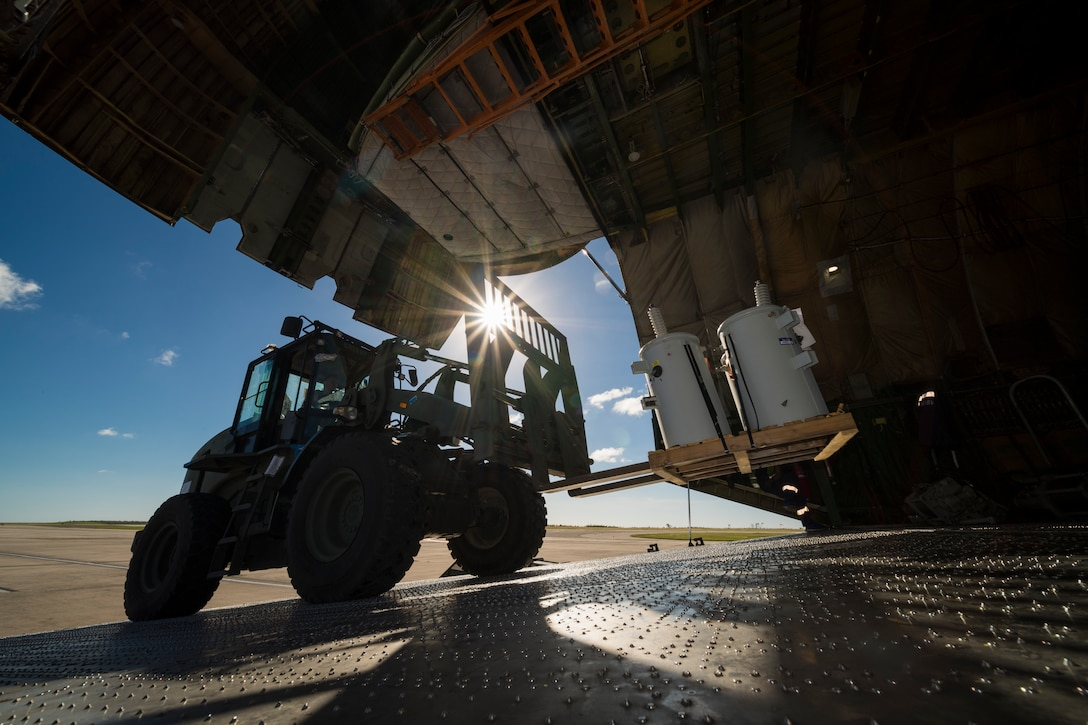 Tech. Sgt. Edward Feilen, 36th Mobility Response Squadron aerial port flight assistant NCO in charge assigned to Andersen Air Force Base, Guam, operates a forklift during flight line operations in Saipan, Commonwealth of the Northern Mariana Islands, Nov. 20, 2018, as part of the Super Typhoon Yutu relief effort.