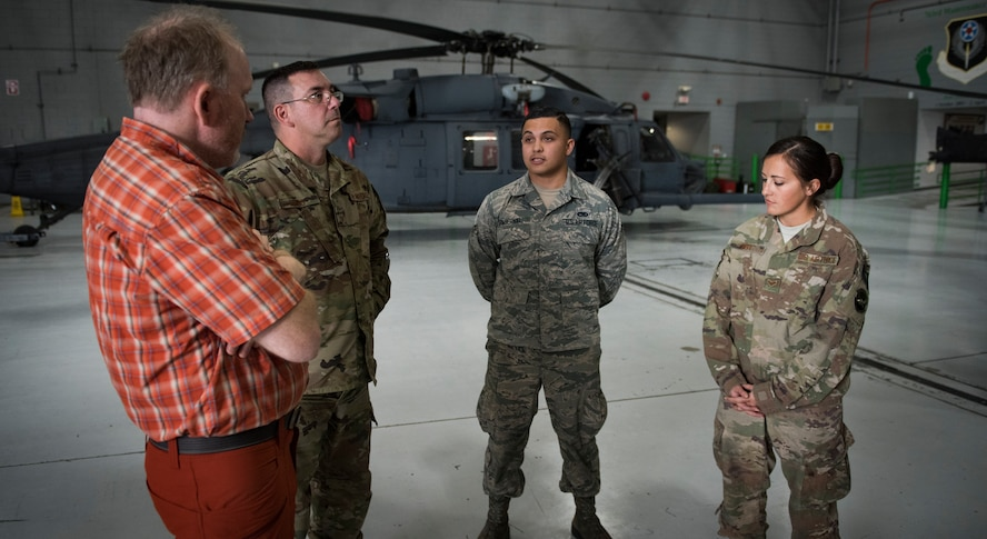 Dr. Daniel Cottam talks to Airmen assigned to the 823rd Maintenance Squadron at Nellis Air Force Base, Nevada, Nov. 16, 2018. The Airmen were part of the team who launched the helicopters that rescued Cottam after a hiking accident. (U.S. Air Force photo by Airman 1st Class Andrew D. Sarver)