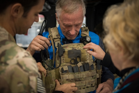 Spencer Cottam tries on a tactical vest in the 823rd Maintenance Squadron hangar at Nellis Air Force Base, Nevada, Nov. 16, 2018. Having taken part in multiple rescues as a civilian, Spencer described the 66th Rescue Squadron as one of the most professional and precise rescues he has ever seen. Spencer visited the 66th RQS with his nephew Dr. Daniel Cottam, following Dr. Cottam's rescue after a fall near Zion Canyon left him severely injured. (U.S. Air Force photo by Airman 1st Class Andrew D. Sarver)
