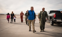 The Cottam family speaks with 66th Rescue Squadron Airmen during a squadron tour at Nellis Air Force Base, Nevada, Nov. 16, 2018. The 66th RQS rescued Dr. Daniel Cottam, his wife and his uncle when Cottam was severely injured after falling during a hike near Zion Canyon, Utah. (U.S. Air Force photo by Airman 1st Class Andrew D. Sarver)