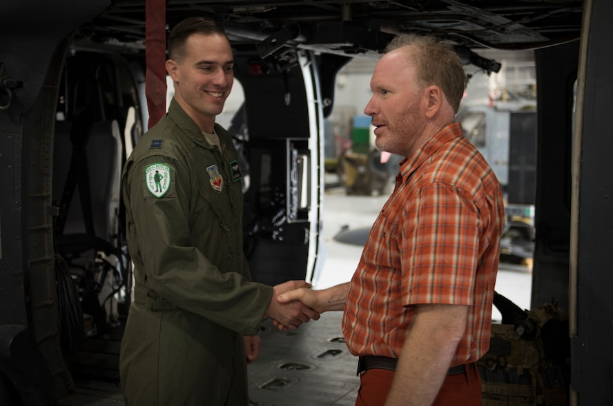 Capt. Ben Gransee, 66th Rescue Squadron HH-60G Pave Hawk helicopter pilot, meets Dr. Daniel Cottam, a bariatric surgeon from Salt Lake City, Utah, at Nellis Air Force Base, Nevada, Nov. 16, 2018. Gransee piloted the helicopter that rescued Cottam after he was severely injured after falling off a cliff when his climbing equipment malfunctioned. (U.S. Air Force photo by Airman 1st Class Andrew D. Sarver)