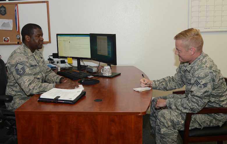 Master Sgt. Jason Greenwell, Career Assistance Advisor, and Senior Airman Jacob Minter, 912th Aircraft Maintenance Squadraon, discuss possible career options at Edwards Air Force Base, California, Nov. 8. (U.S. Air Force photo by Giancarlo Casem)
