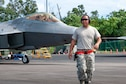 Tech. Sgt. Brad Kaai, 154th Aircraft Maintenance Squadron crew chief, walks ahead of an F-22 Raptor taxing in at the Hilo International Airport
