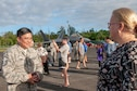 Master Sgt. Ryan Ooka, 154th Maintenance Squadron maintenance supervisor speaks with a member of the public during an F-22 Raptor exhibit held at the Hilo International Airport.