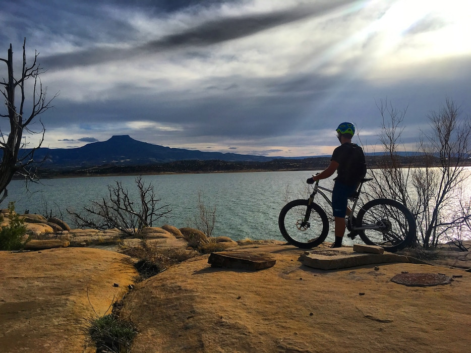 ABIQUIU LAKE, N.M. – A mountain biker pauses to enjoy the sunset view of the lake and Cerro Pedernal, April 1, 2018. Photo by Tucker Feyder. This 2018 photo drive entry tied for third place based on employee voting.