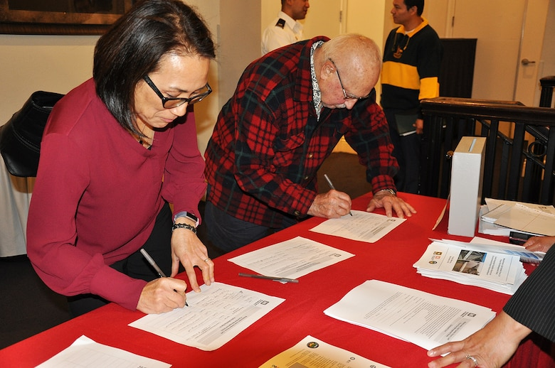 Community members who live in the Westminster Watershed sign in before the start of a Nov. 8 public meeting about the Westminster/East Garden Grove Flood Risk Management Study in Huntington Beach, California.