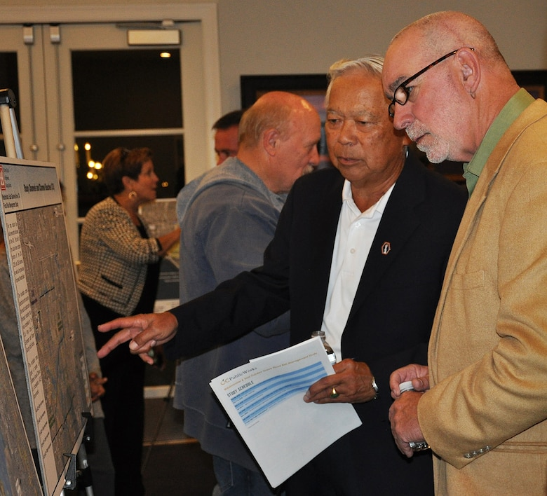 Community members who live in the Westminster Watershed look over maps of a proposed project to reduce flood risk in their area during a Nov. 8 public meeting about the Westminster/East Garden Grove Flood Risk Management Study in Huntington Beach, California.
