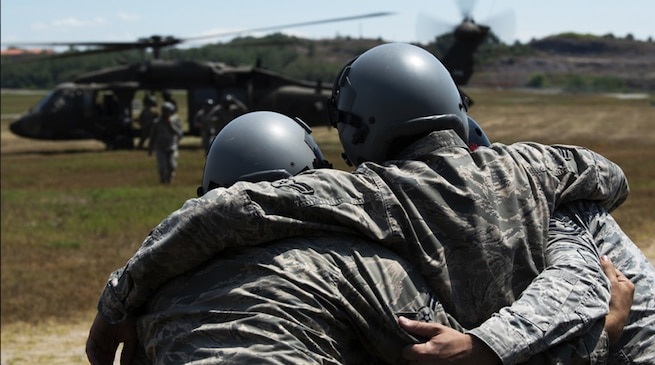 8th Fighter Wing Airmen help a simulated casualty move toward a UH-60 Blackhawk helicopter from U.S. Army Garrison Humphreys during personnel recovery training Aug. 15, 2018, at Kunsan Air Base, Republic of Korea. In this exercise, it is likely each participant would have used the Personnel Recovery Command and Control software system to upload their vital statistics prior to deployment. Program Executive Office Digital at Hanscom Air Force Base, Mass., supports and sustains that system using agile software development processes. (U.S. Air Force photo by Senior Airman Stefan Alvarez)