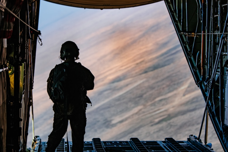 C-130 aircrew delivers combat supplies through air drop