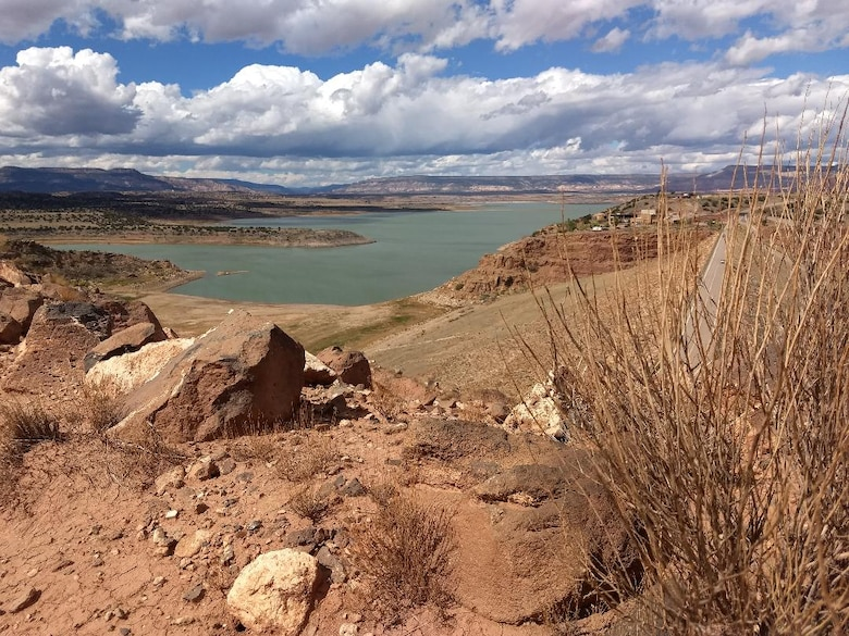 ABIQUIU LAKE, N.M. – Clouds dot the sky over the lake, July 1, 2018, as seen from the piezometer road. Photo by Clarence Maestas. This was a 2018 photo drive entry.