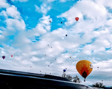 ALBUQUERQUE, N.M. – Hot air balloons dot the sky over the District office during the Albuquerque International Balloon Fiesta, Oct. 9, 2018. Photo by Jeannette Alderete. This was a 2018 photo drive entry.