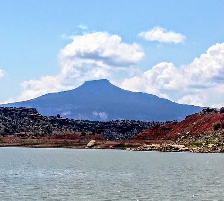 ABIQUIU LAKE, N.M. -- Clouds float above Cerro Pedernal at the northern part of the lake, July 1, 2018. Photo by Clarence Maestas. This was a 2018 photo drive entry.