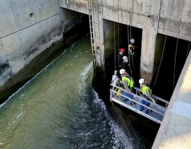 COCHITI DAM, N.M. – The inspection team enters one of the dam's three conduits during a Hydraulic Steel Structure Inspection, Nov. 13, 2017. The three conduits measure approximately 1,354 feet in length. Photo by Tracy Wolf. This was a 2018 photo drive entry.