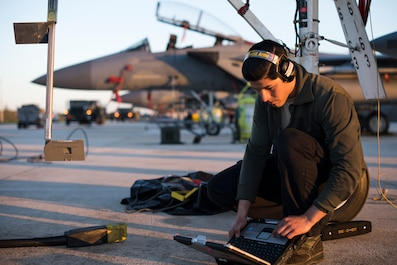 A maintainer assigned to the 493rd Aircraft Maintenance Unit looks through his technical orders while conducting maintenance on an F-15C Eagle assigned to the 493rd Fighter Squadron Nov. 21, 2018, to prepare it for sorties in support of the NATO Tactical Leadership Programme 18-4 at Amendola Air Base, Italy. F-15C Eagles and an F-15D Eagle will be participating in the NATO Tactical Leadership Programme 18-4. With over four decades of history, TLP has become the focal point for NATO's Allied Air Forces tactical training, developing knowledge and leadership skills, necessary to face today's air tactical challenges. (U.S. Air Force photo/ Senior Airman Malcolm Mayfield)