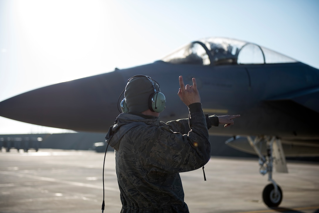 A maintainer assigned to the 493rd Aircraft Maintenance Unit taxis out an F-15C Eagle assigned to the 493rd Fighter Squadron for a sortie in support of the NATO Tactical Leadership Programme 18-4 at Amendola Air Base, Italy, Nov. 22, 2018. F-15C Eagles and an F-15D Eagle will be participating in the NATO Tactical Leadership Programme 18-4. TLP has prepared hundreds of NATO and allied forces' flight leaders to be mission commanders. (U.S. Air Force photo/ Senior Airman Malcolm Mayfield)