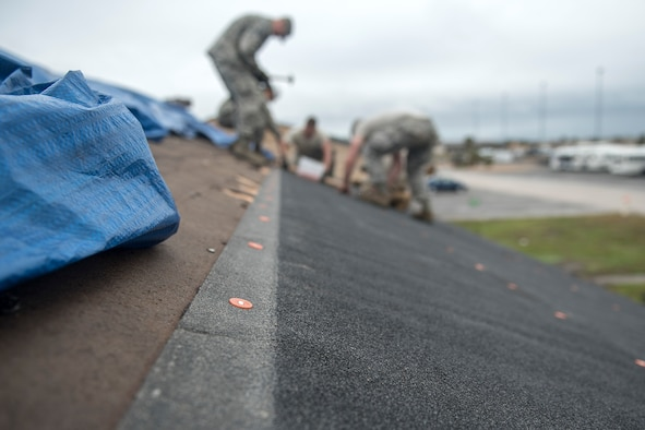TF Phoenix Airmen repair building roofs