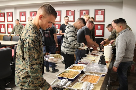 CAMP HUMPHREYS, Republic of Korea - U.S. Marine Corps Forces Korea Marines enjoy their Thanksgiving Meal provided by the spouses of Marines from across the combined joint services here, Nov. 21.  The Marine spouses wanted the Marines to have a nice home cooked meal as a team before departing for the holiday. (Official U.S. Marine Corps photos by Capt. John Parry/Released)