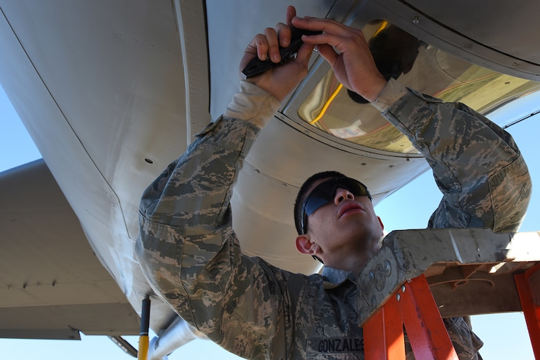 U.S. Air Force Airman 1st Class Richard Gonzales, 22nd Expeditionary Aircraft Maintenance Unit KC-135 Stratotanker crew chief, replaces a boom sighting window at Incirlik Air Base, Turkey, Nov. 15, 2018.