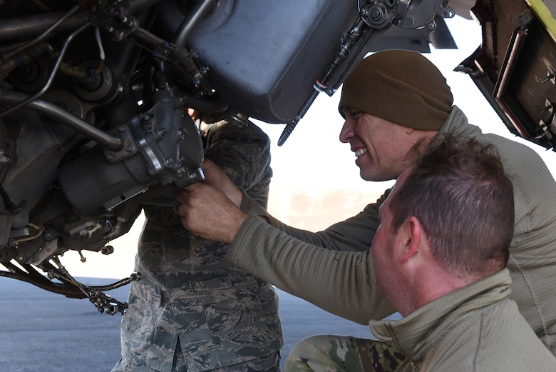 U.S. Air Force members take apart an engine on a KC-135 Stratotanker at Incirlik Air Base, Turkey, Nov. 15, 2018.